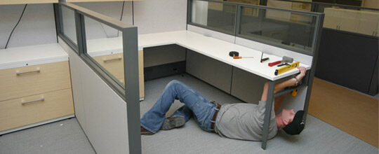 man repairing cubicle